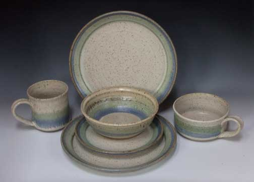 Solid Teal - a blend of Green and Blue Speckled Off White with Blue and Green Stripes Speckled Off White with golden Brown with Blue stripe & Pistacio Potter_Dinnerware
